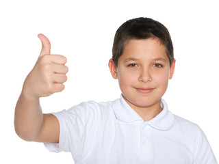 Preteen boy in the white shirt holds his thumb up