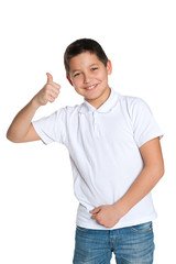 Young boy in the white shirt holds his thumb up