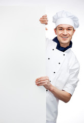 chef showing sign billboard
