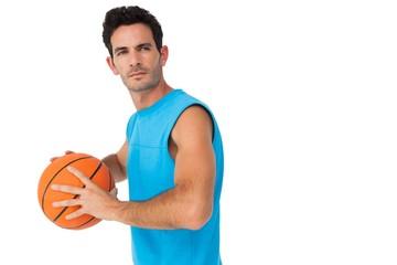 Serious basketball player with ball