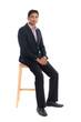 Full body indian business man sitting