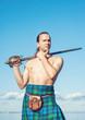 Scottish man with sword