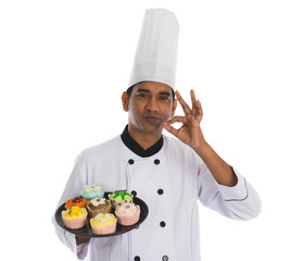 indian male chef with tasty ok sign and white background