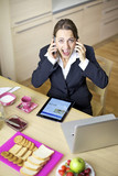 Business woman shouting having conversation with two phones