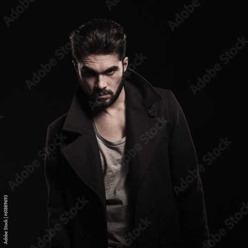 fashion young bearded man wearing long coat with big collars