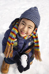 boy with small snowman