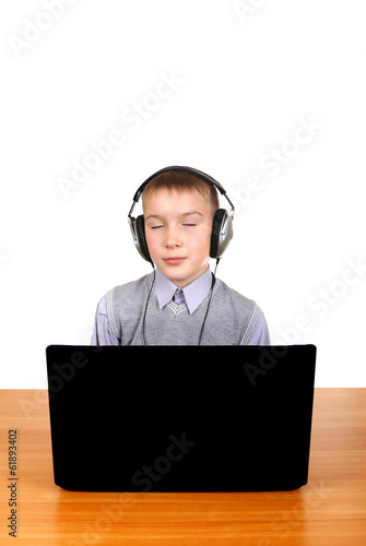 Kid in Headphones behind Laptop