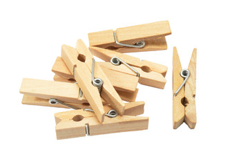 Wooden clothespins on the white background