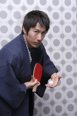 man in yukata playing table tennis