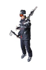 One male skier showing how to carry full equipment