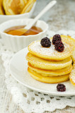Small pancakes with honey