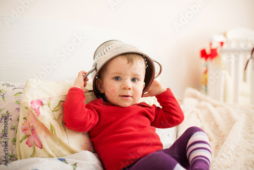 Smiling Child with Strainer