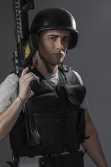 paintball sport player wearing protective helmet aiming pistol ,