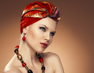 Beauty fashionable woman with hairs wrapped in turban