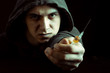 Grunge image of a depressed drug addict looking at a syringe