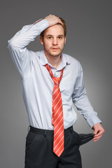 businessman showing his empty pocket, turning his pocket inside