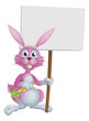 Pink bunny rabbit with carrot and sign