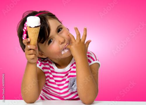 little girl eating ice cream - 61899496