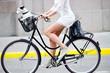 Leinwanddruck Bild - Side shot of woman on bike