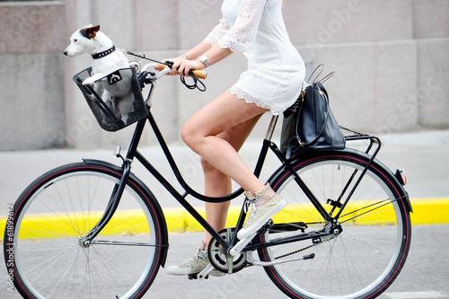 Leinwanddruck Bild Side shot of woman on bike