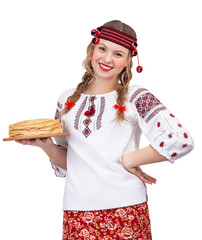 Girl with crepes in traditional clothes