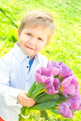 sweet child holding a bouquet tulips for mothersday