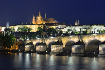 Vltava river, Charles Bridge and St. Vitus Cathedral at night