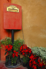 Italian style mailbox with flower