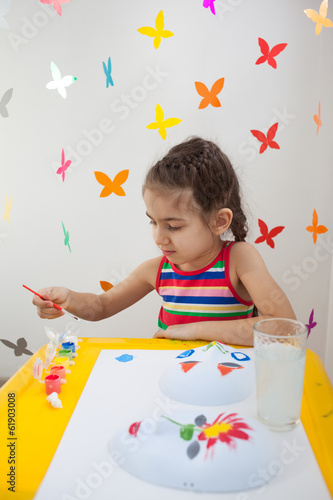 Child painting in playroom