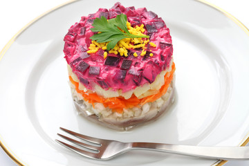 Russian traditional salad, dressed herring under fur coat