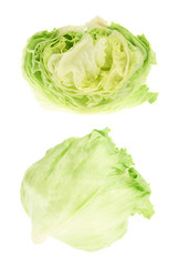 Whole and sliced green cabbage