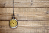 Antique pocket watch on wooden background