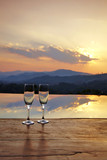 champagne glass on mountain background in sunset