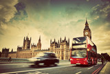 London, the UK. Red bus, taxi cab in motion and Big Ben