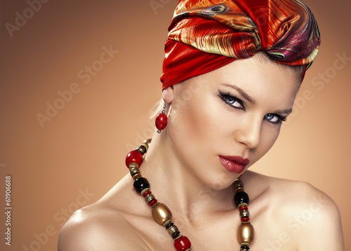 Fashion portrait of beautiful Caucasian woman wearing turban