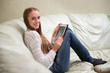 Young woman with tablet pc on the sofa
