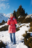 Young woman take a walk on winter mountain slope