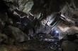 Caver in a cave, Pugnetto, Mezzenile, Piedmont, Italy - 61908605