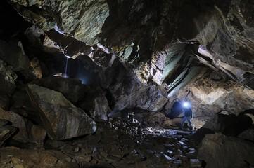 Caver in a cave, Pugnetto, Mezzenile, Piedmont, Italy