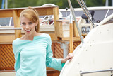 Beautiful fashion woman at the wooden old Yacht
