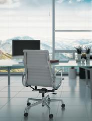 Modern desk and armchair against huge window