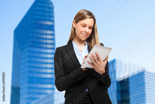 Smiling businesswoman using a tablet