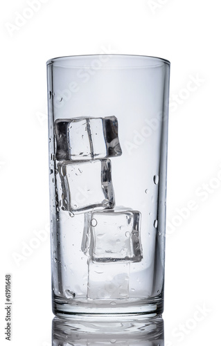 Wet empty transparent glass with ice cubes