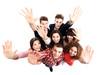 Group of happy joyful friends standing with hands up