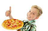 Little boy preparing homemade pizza