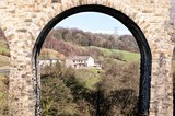 Countryside landscape through arch