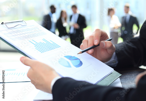 male hand pointing at business document during discussion