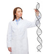 young female doctor writing dna molecule