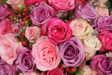 purple and pink roses wedding arrangement