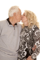 elderly couple close kiss